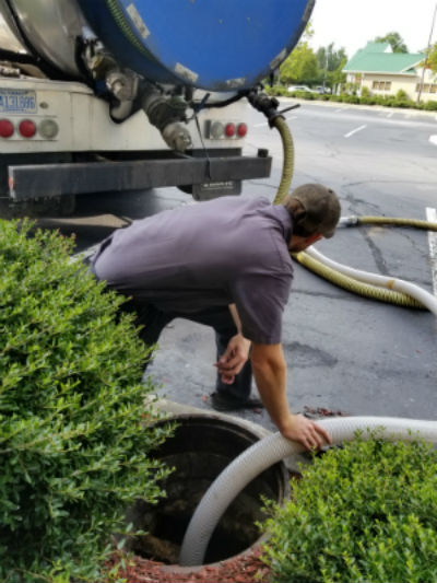 Pumping a grease trap